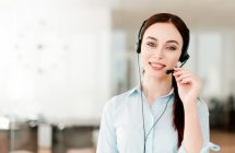 smiling-young-office-worker-with-headset-answering-call-center-woman-talking-with-clients-portrait-attractive-customer-technical-support-representative_97712-11